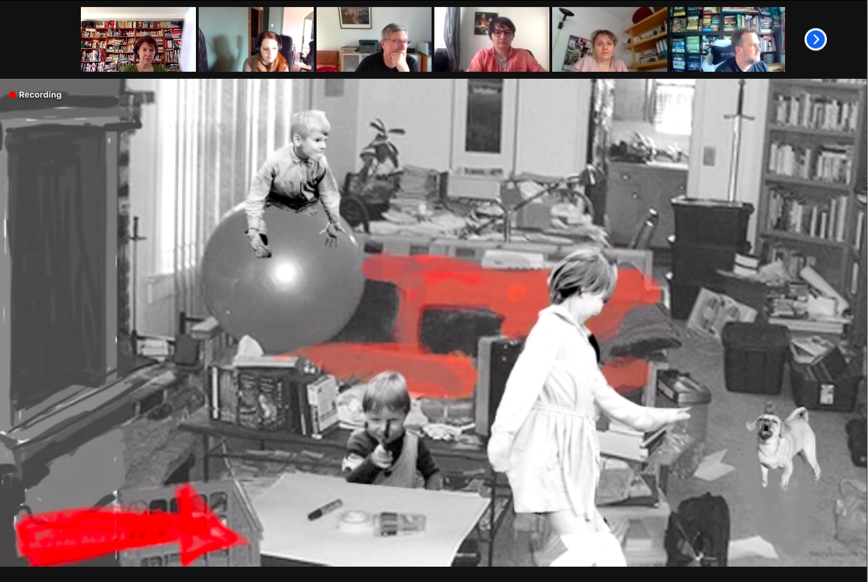 A screenshot of a zoom meeting. Images of teh attendees are visible at the top of teh screen and a screenshare shows a collage of an office with a child on an inflatable ball with other children playing in the space.
