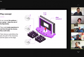 A screenshot from a zoom meeting. There is a diagram displaying an auditorium with a stage. The text indicates that the audience can determine outcomes on teh stage by the use of in-seat technology.